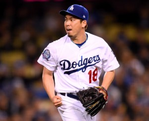 LOS ANGELES, CA - MAY 23:  Kenta Maeda #18 of the Los Angeles Dodgers reacts to his strikeout of Gerardo Parra #8 of the Colorado Rockies to end the sixth inning at Dodger Stadium on May 23, 2018 in Los Angeles, California.  (Photo by Harry How/Getty Images)