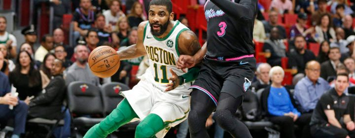 Boston Celtics guard Kyrie Irving (11) drives to the basket against Miami Heat guard Dwyane Wade (3) during the second half of an NBA basketball game, Thursday, Jan. 10, 2019, in Miami. (AP Photo/Joel Auerbach)