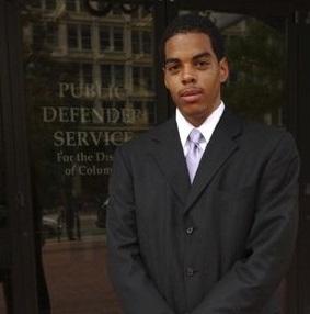 Student standing in front of door to Public Defender Service for DC