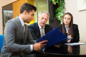 business people look at document