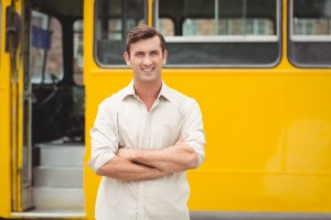 Man stands in front of bus