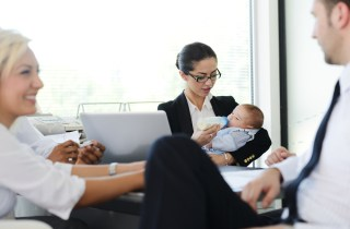 business woman with baby in meeting