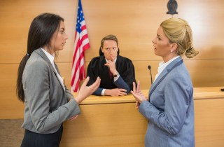 female attorneys argue in front of judge