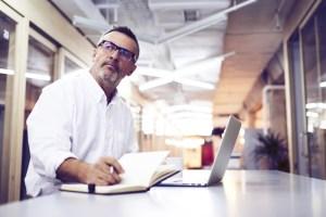 man standing at laptop