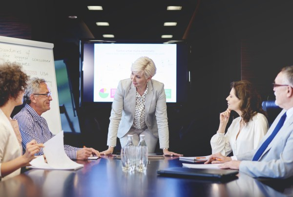 female CEO leads meeting