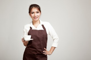 waitress with a mug and hand on hip