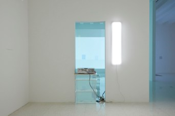 ex2016lk_ins Visual Arts, Exhibitions; installation views. Lee Kit - Hold your breath, dance slowly May 12 - October 9, 2016, Burnet Gallery. The first US solo museum exhibition of artist Lee Kit (b. 1978) features work from the past five years, including an ambitious 13-channel video installation acquired by the Walker—I can't help falling in love (2012)—alongside a newly commissioned site-specific installation. Lee creates poetic object-based installations fashioned from everyday materials and household items such as soap, towels, cardboard boxes, and plastic containers, which he transforms through subtle gestures of painting, drawing, and placement. Originally from Hong Kong and based in Taiwan, Lee frequently imparts political commentary in his work through an embedded use of foreign products and English words that reference the omnipresence of market capitalism surrounding Hong Kong's history as a global city living under the principle of one country, two systems. The artist received shortlist nomination for the 2013 Hugo Boss Asia Art Award and represented Hong Kong in the 2013 Venice Biennale. Curator: Misa Jeffereis
