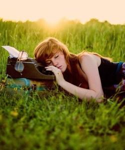 photo of a writer asleep on a typewriter