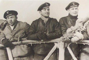 Georg Högel (centre) aboard U30, January 1940.
