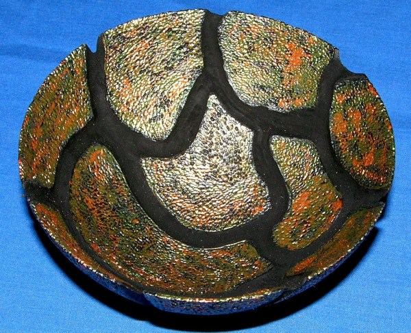 """Dennis Montville, """"Carapace"""" - A piece inspired by the outer shell (carapace) of many beautiful beetles from throughout the world. woodturning, carving, texturing and acrylics, 2 x 4, $75"""