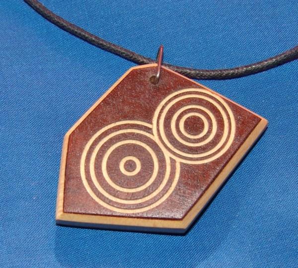 "Dennis Montville, ""Necklace A"" wood, cord, 2 x 2, $19.50"