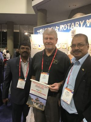Al Hombroek with Rotary Club of Lawrenceville was invited to exchange flags with these gentlemen from India at the International Rotary Convention.