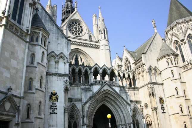 Entrance and front view of the Royal Courts of Justice in the City of London.  Note the coat of arms on your left.