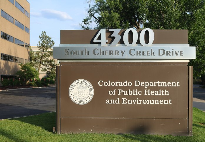 A sign for the Colorado Department of Public Health and Environment building.