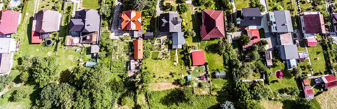 Houses on their plots of land from the air as an example. A foreigner can own the house but not the land.