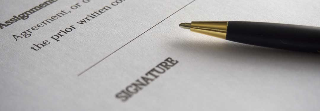 A pen at the signature line. A sample mortgage contract can be found here.