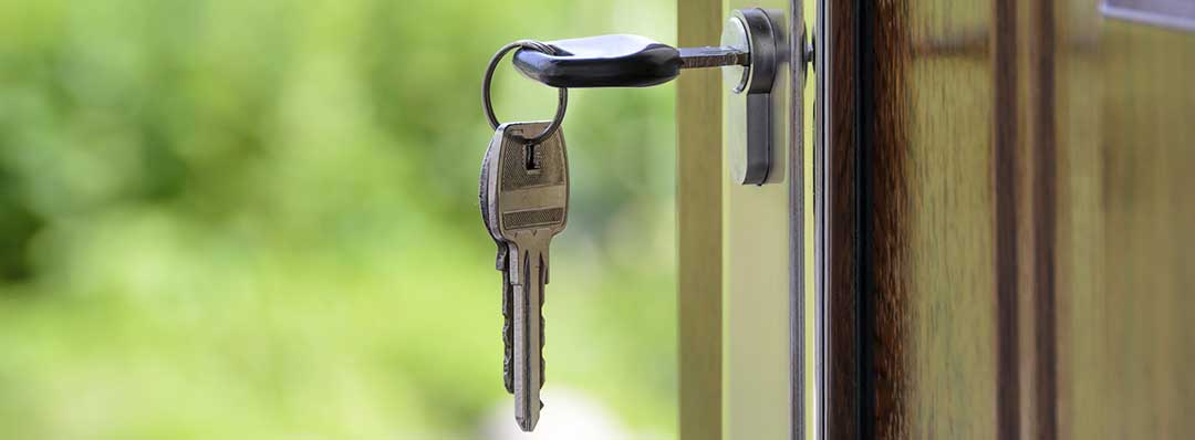 Key in an unlocked door to denote rental, which is considered interest in an unwritten mortgage.