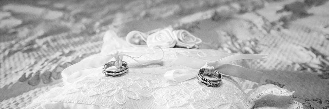 Wedding rings on a pillow to illustrate the Quiao marriage, which was governed by the conjugal partnership of gains regime.