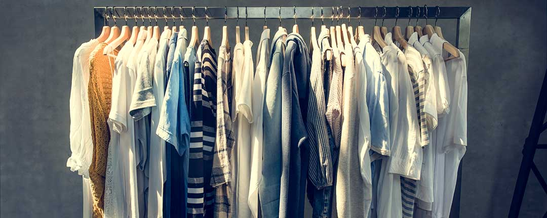 A rack of clothes hanging from a metal rod.