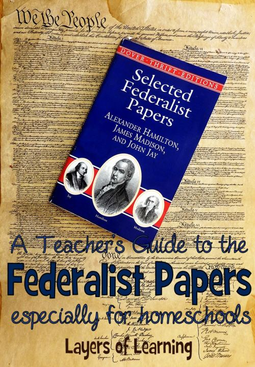 The Federalis tPapers on top of a copy of the Constitution