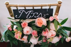Florals on the back of the bride's chair