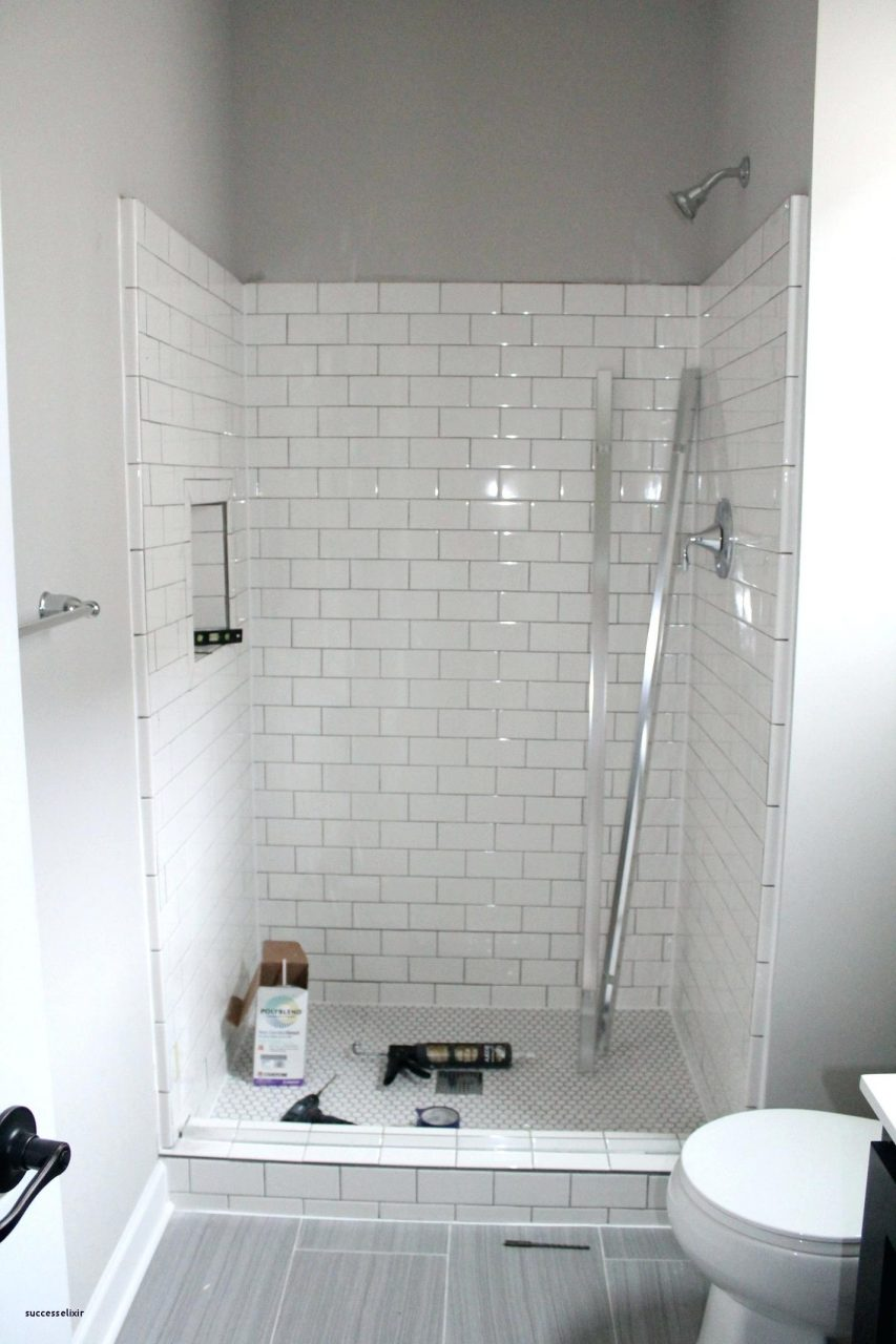 small bathroom with white subway tile