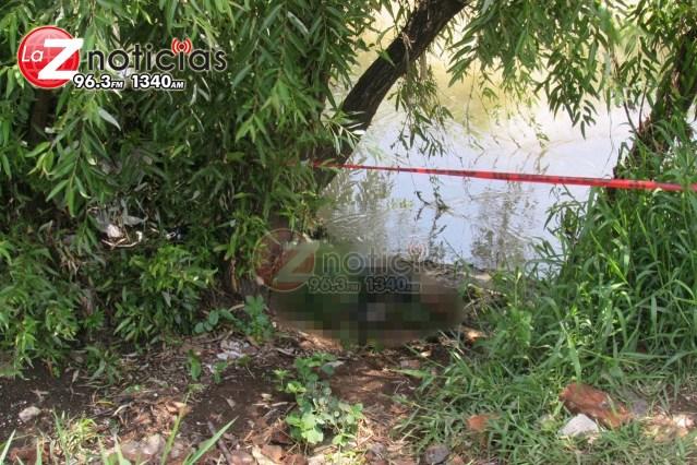 Localizan a hombre muerto a la orilla de un río en Morelia