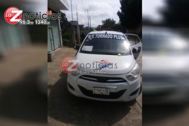Hallan un decapitado dentro de taxi en Zitácuaro