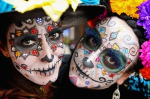 MEXICO: Girls in facepaint in Real del Monte on the 'Day of the Dead' on November 2, 2014 in Hidalgo,Mexico. The Royal Couple are on the first day of a four day visit to Mexico as part of a Royal tour to Colombia and Mexico. Chris Jackson/Getty Images/AFP == FOR NEWSPAPERS, INTERNET, TELCOS & TELEVISION USE ONLY ==