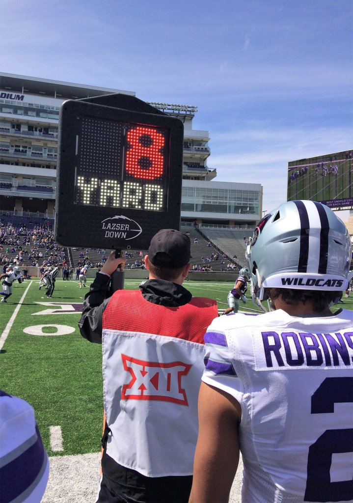 Lazser Down, sidelines, distance marker, down maker, laser down, football, kansas state football, kansas state university, ksu football, kansas state university football, wildcats, wildcat football, emaw
