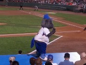 Ironbirds' mascot Ferrous mocks opponents swinging and missing while up to bat.