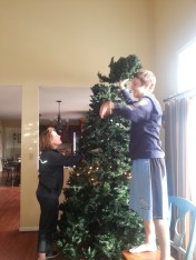 My younger brother, Parker, had to put the top on the tree because he was the only one who could reach the top.