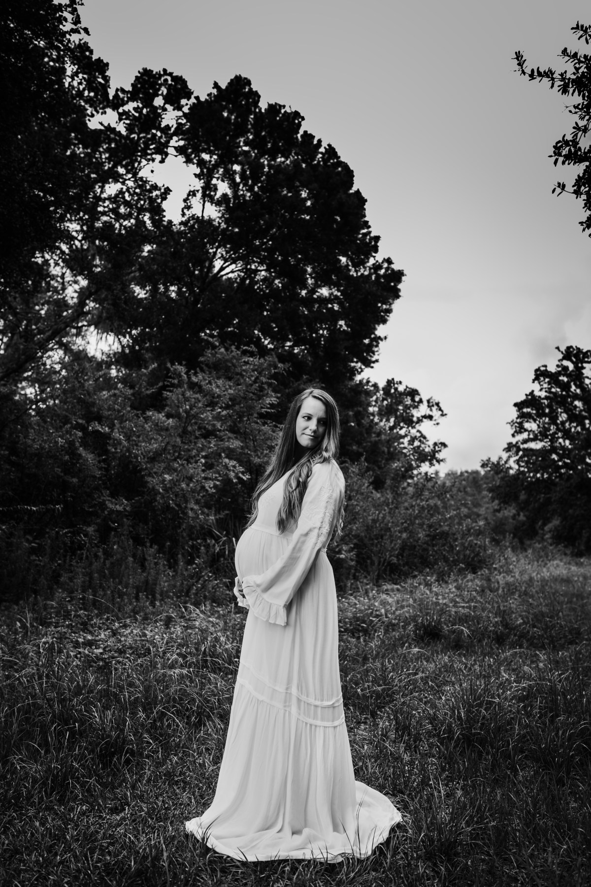 pregnant mother standing in a tampa field maternity session