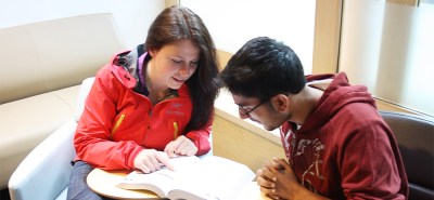 A student being tutored in the Learning Commons.