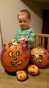 Two-year-old son with pumpkin