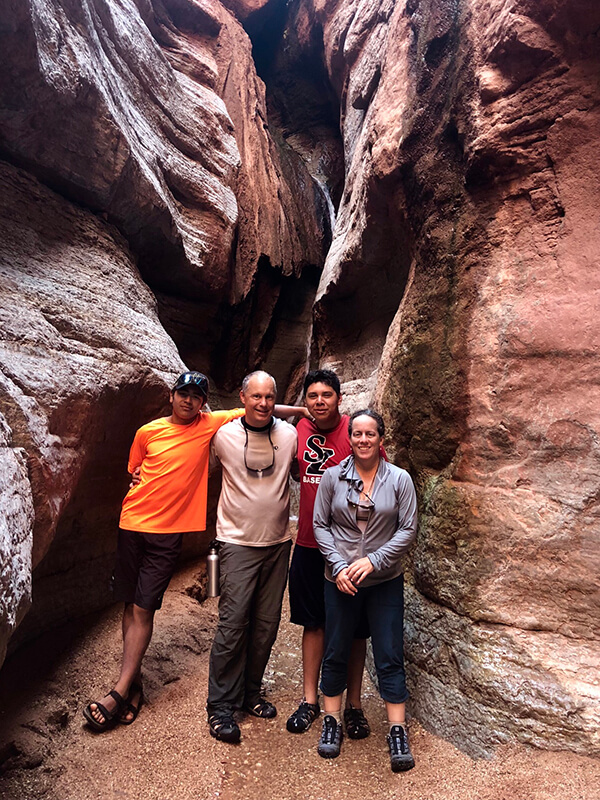 Karen Cunningham hiking a canyon with family