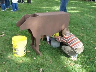 Milking a pretend cow