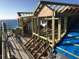 Start building two dormers and a flat roof