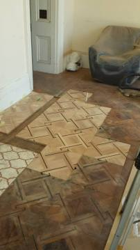 Section of floor removed and replaced with new floor panels