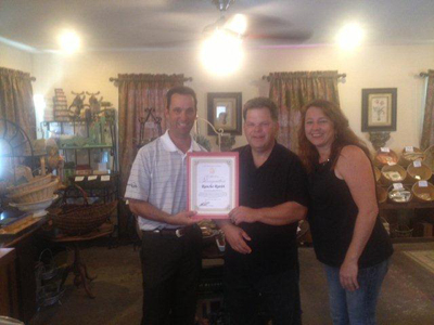 Senator Steve Knight presents a Certificate of Recognition to business partners Lee Baron and Susan Jankowski.