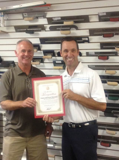 Senator Steve Knight presents Outstanding Small Business Award to Randy Jaqua.