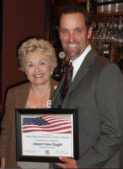 Senator Knight accepts a certificate from SCRWF President, Paige Weaver. Photo courtesy of Tammy Messina.