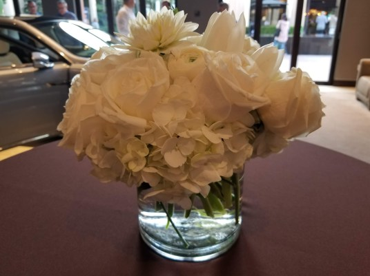 Flowers lend elegance to preview party.