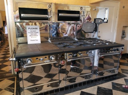 Huge antique stove is centrpiece of the kitchen.