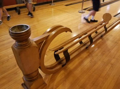 Ornate ball caddy is bowling alley feature.