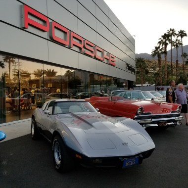Classic Corvette and Lincoln adorn Porsche parking lot