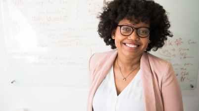 woman standing near whiteboard