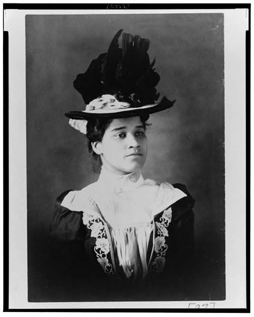 [African American woman, head-and-shoulders portrait, wearing hat, facing slightly right]
