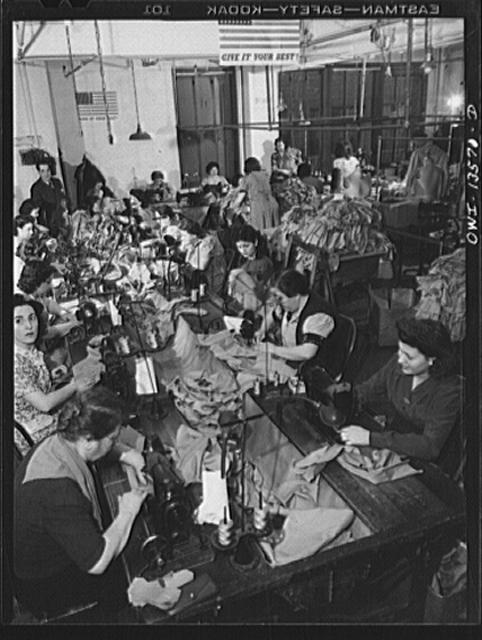 New York, New York. Garment workers in the N.M. dress shop which is now making uniforms for the Women's Army Auxiliary Corps (WAAC). They are members of local 89 of the International Ladies Garment Worker's Union, predominantly Italian
