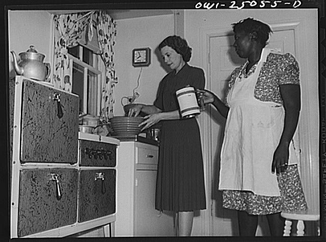 San Augustine, Texas. Mrs. Ramsey, a lawyer's wife, with her maid in the kitchen